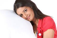 Girl with white pillow Stock Photos
