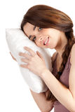 Girl with white pillow Stock Images