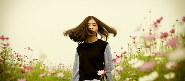 Girl on White and Pink Cosmos Flower Field Photography Royalty Free Stock Photo