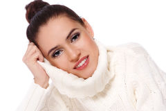 Girl in white pullover. Young beautiful happy smiling girl in handmade pullover over white background stock photo