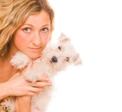 Girl with a white puppy Royalty Free Stock Photography
