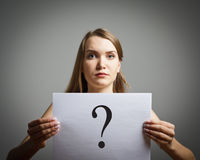 Girl in white and question. Stock Photos