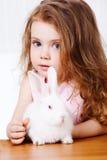 Girl and white rabbit Royalty Free Stock Photo