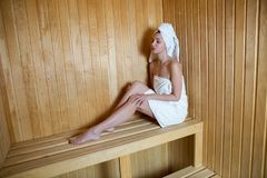 Girl with white robe sitting Royalty Free Stock Image