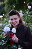 Girl in white-rose garden with two roses(portrait  Stock Photography