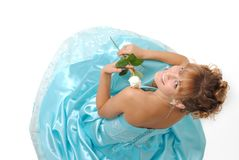 Girl with white rose wearing a dress Stock Images