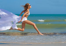 Girl in white running with the wind Stock Images