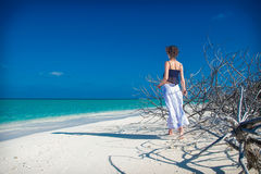 Girl on white sand beach with thorny. Photo of the Girl on white sand beach with thorny Royalty Free Stock Photo