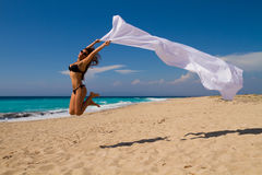 Girl With White sarong on The Beach. Stock Photo