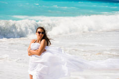 Girl With White sarong on The Beach. Royalty Free Stock Images