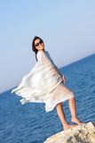 Girl in white sarong standing on the beach Royalty Free Stock Photos