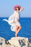 Girl in white sarong standing on the big stone Stock Photo