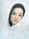 Girl in white scarf. Young woman in a white scarf stock image
