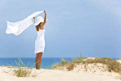 Girl in white by the sea Stock Images