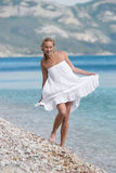 Girl in white at the sea Stock Photos