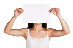 Girl with a white sheet of paper before her fase Stock Photos