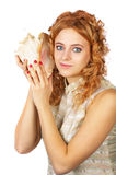 Girl on white with shell Stock Images
