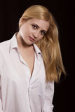The girl in a white shirt. Beautiful blonde in a white man's shirt royalty free stock images