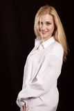 The girl in a white shirt. Beautiful blonde in a white man's shirt royalty free stock photography