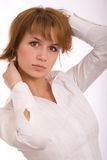 The girl in a white shirt. Glamour girl on a white background royalty free stock photography