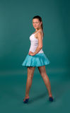 Girl in a white shirt and blue skirt Stock Photography