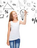 Girl in white shirt drawing idea on virtual screen. Education and new technology concept - smiling teenage girl in white shirt drawing idea on vitual screen royalty free stock image