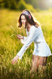 Girl with white shirt on the field at sunset Stock Images