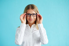 Girl in white shirt with glasses Royalty Free Stock Image
