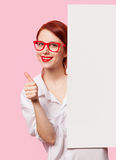 Girl in white shirt and glasses with white board Royalty Free Stock Image