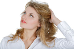 Girl in a white shirt looking up Stock Photography