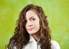 Girl in white shirt over green Stock Photography