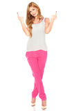 Girl in a white shirt and pink pants Stock Photography