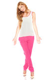 Girl in a white shirt and pink pants Royalty Free Stock Image