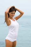 Girl in white shirt in the sea Stock Photography