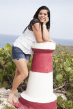 Girl white shirt on small lighthouse royalty free stock images