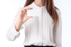 Girl in white shirt stands up straight and keeps itself the paper leaf close- Stock Images