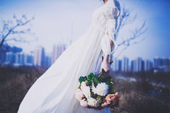 Girl in white skirt holding flowers Royalty Free Stock Photos