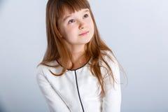 Girl in white. Smiling little girl in the white dress Stock Image