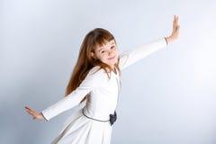 Girl in white. Smiling little girl in the white dress Royalty Free Stock Photo