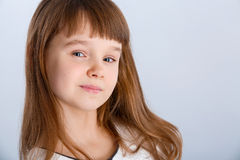 Girl in white. Smiling little girl in the white dress Royalty Free Stock Photography