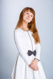 Girl in white. Smiling little girl in the white dress Royalty Free Stock Images