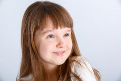 Girl in white. Smiling little girl in the white dress Royalty Free Stock Image