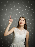 Girl in white and snowflakes. Stock Image