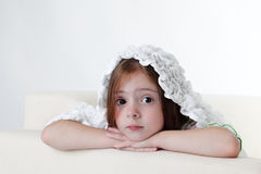 Girl on white sofa Royalty Free Stock Images