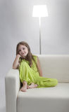 Girl on white sofa Stock Photography
