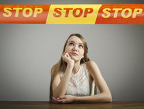 Girl in white and STOP line. Royalty Free Stock Images
