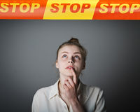 Girl in white and STOP line. Royalty Free Stock Photos