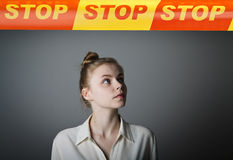 Girl in white and STOP line. Stock Image