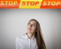 Girl in white and STOP line. Stock Photo