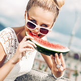 Girl in white summer dress eat watermelon Royalty Free Stock Photo